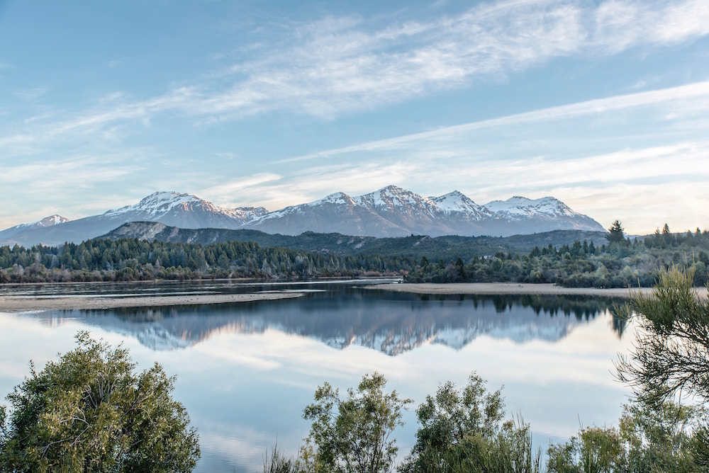Crystal clear lake and a backdrop of snow-covered mountains